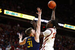 Iowa State forward Solomon Young, right, shoots over West Virginia forward Logan Routt during the first half of an NCAA college basketball game Tuesday, March 3, 2020, in Ames, Iowa. (AP Photo/Matthew Putney)
