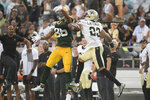 New Orleans Saints cornerback Marshon Lattimore (23) breaks up a pass intended for Green Bay Packers wide receiver Malik Taylor, left, during the second half of an NFL football game, Sunday, Sept. 12, 2021, in Jacksonville, Fla. (AP Photo/Phelan M. Ebenhack)