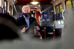 Democratic presidential candidate former Vice President Joe Biden speaks with invited guests aboard an Amtrak train, Wednesday, Sept. 30, 2020, as it makes its way to Alliance, Ohio. Biden is on a train tour through Ohio and Pennsylvania today. (AP Photo/Andrew Harnik)
