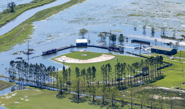 A flooded recreational area is seen in the aftermath of Hurricane Delta Saturday Oct. 10, 2020, in Iowa, La. (Bill Feig/The Advocate via AP, Pool)