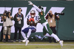 New England Patriots' Phillip Dorsett, left, catches a pass for a touchdown in front of New York Jets' Trumaine Johnson during the first half of an NFL football game Monday, Oct. 21, 2019, in East Rutherford, N.J. (AP Photo/Bill Kostroun)