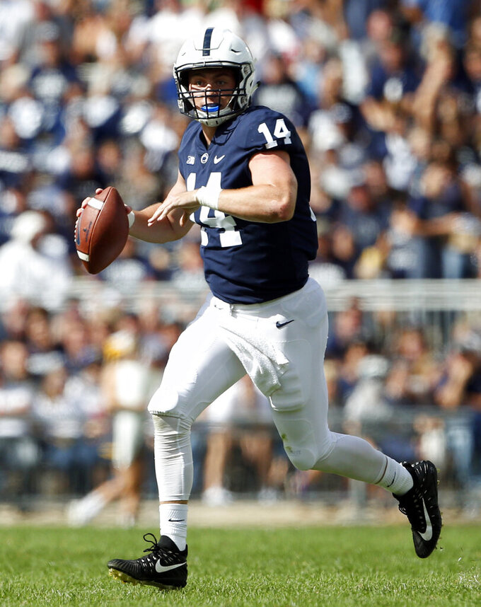 FILE - In this Sept. 15, 2018, file photo, Penn State quarterback Sean Clifford (14) rolls out of the pocket against Kent State during the second half of an NCAA college football game in State College, Pa. Penn State appears set to go with junior Sean Clifford after fifth-year senior Tommy Stevens entered the NCAA transfer portal. (AP Photo/Chris Knight, File)
