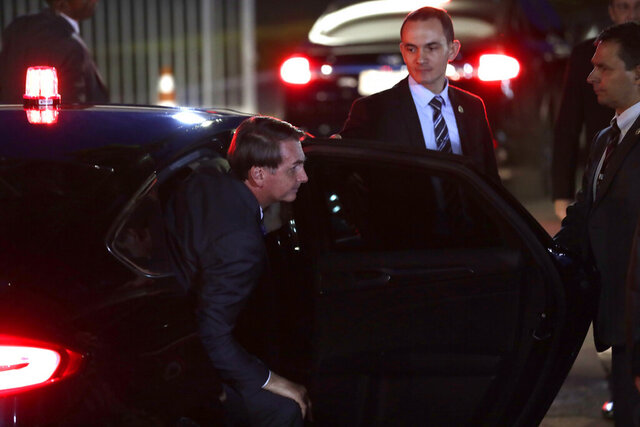Brazil's President Jair Bolsonaro arrives to his official residence, Alvorada Palace, in Brasilia, Brazil, Wednesday, Jan. 8, 2020. (AP Photo/Eraldo Peres)