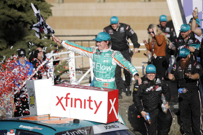 Brandon Jones celebrates in Victory Lane after winning a NASCAR Xfinity Series auto race at Kansas Speedway in Kansas City, Kan., Saturday, Oct. 19, 2019. (AP Photo/Orlin Wagner)