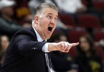 FILE - In this Friday, March 15, 2019, file photo, Purdue head coach Matt Painter directs his top team during the first half of an NCAA college basketball game against Minnesota in the quarterfinals of the Big Ten Conference tournament in Chicago. In a landscape where one-and-done or two-and-done players have become all the rage, Painter has largely ignored the trend by building Purdue's program with players who expect to stay four years and cherish a degree. (AP Photo/Nam Y. Huh, File)