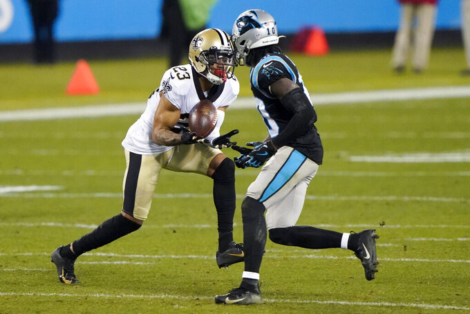 New Orleans Saints cornerback Marshon Lattimore intercepts a pass intended for Carolina Panthers wide receiver Curtis Samuel during the second half of an NFL football game Sunday, Jan. 3, 2021, in Charlotte, N.C. (AP Photo/Brian Blanco)