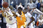 Auburn guard Samir Doughty (10) and Tennessee guard Davonte Gaines (0) chase down the ball during the first half of an NCAA college basketball game Saturday, Feb. 22, 2020, in Auburn, Ala. (AP Photo/Julie Bennett)