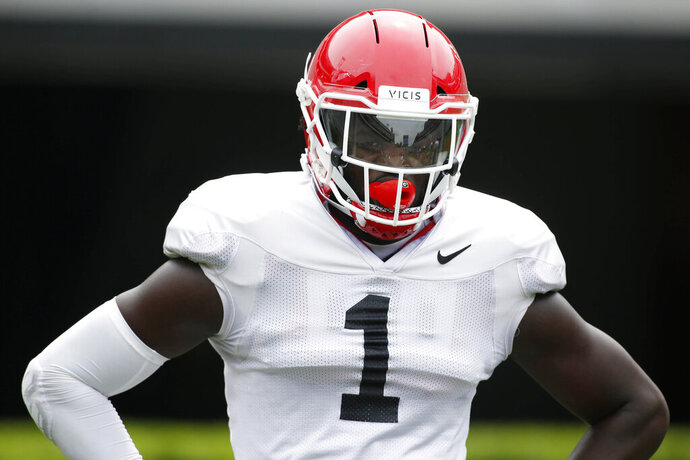 FILE - Georgia outside linebacker Brenton Cox (1) looks on during warm ups before an NCAA college football scrimmage in Athens, Ga., Saturday, April 13, 2019. No. 5 Florida will rely on a number of newcomers, including Brendon Cox, as it tries to dethrone rival Georgia in the Southeastern Conference's East Division. Some of them are freshmen, others are transfers.  (Joshua L. Jones/Athens Banner-Herald via AP, File)