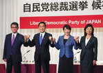 Candidates for the presidential election of the ruling Liberal Democratic Party pose prior to a joint news conference at the party's headquarters in Tokyo, Japan, Friday, Sept. 17, 2021. The contenders are from left to right, Taro Kono, the cabinet minister in charge of vaccinations, Fumio Kishida, former foreign minister, Sanae Takaichi, former internal affairs minister, and Seiko Noda, former internal affairs minister. Official election campaigning kicked off Friday for the new head of Japan's governing party LDP, whose winner is almost assured to become next Japanese prime minister.(Kimimasa Mayama/Pool Photo via AP)