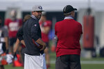 San Francisco 49ers head coach Kyle Shanahan, left, talks with general manager John Lynch during NFL football practice in Santa Clara, Calif., Saturday, Aug. 22, 2020. (AP Photo/Jeff Chiu, Pool)