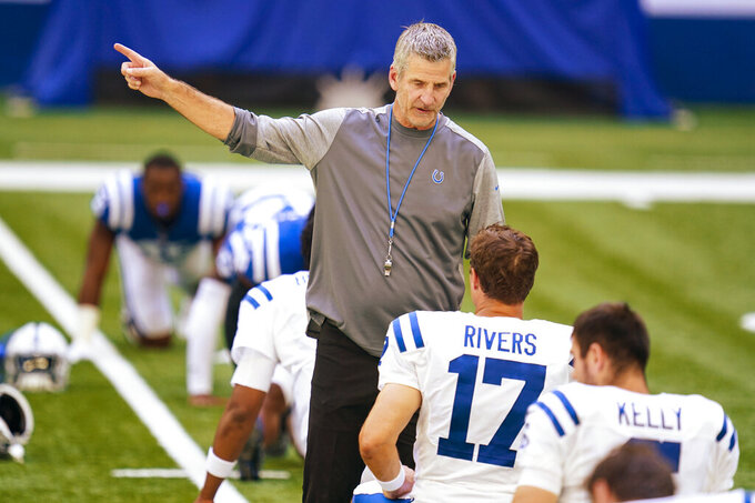 Indianapolis Colts head coach Frank Reich talks with quarterback Philip Rivers (17) during practice at the NFL team's football training camp at Lucas Oil Stadium in Indianapolis, Monday, Aug. 24, 2020. (AP Photo/Michael Conroy)