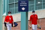 Boston Red Sox's Matt Barnes, right, walks to a bus with a teammate to be transported to an off-site facility for better social distancing between players out of concern for the coronavirus before baseball practice at Fenway Park, Sunday, July 5, 2020, in Boston. (AP Photo/Michael Dwyer)