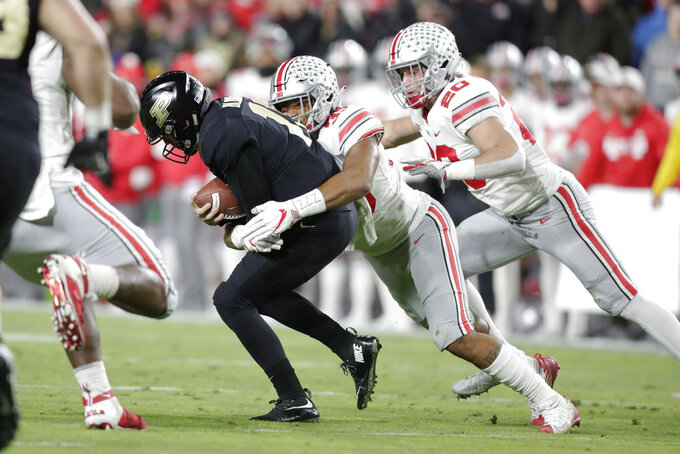 Ohio State linebacker Malik Harrison (39)] sacks Purdue quarterback David Blough (11) during the first half of an NCAA college football game in West Lafayette, Ind., Saturday, Oct. 20, 2018. (AP Photo/Michael Conroy)