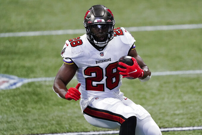 Tampa Bay Buccaneers running back Leonard Fournette (28) runs against the Atlanta Falcons during the second half of an NFL football game, Sunday, Dec. 20, 2020, in Atlanta. (AP Photo/John Bazemore)