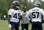 Seattle Seahawks linebacker Shaquem Griffin (49) and linebacker Cody Barton (57) go through drills during an NFL football practice, Wednesday, May 29, 2019 in Renton, Wash. (Erika Schultz/The Seattle Times via AP)