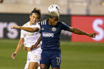 Atlanta United's Santiago Sosa, left, heads the ball away from Philadelphia Union's Sergio Santos, right, during the first half of a CONCACAF Champions League soccer match, Tuesday, May 4, 2021, in Chester, Pa. (AP Photo/Chris Szagola)