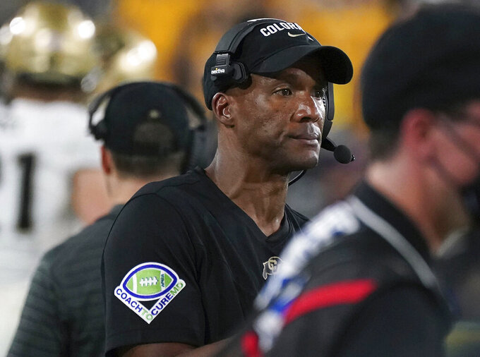 Colorado head coach Karl Dorrell watches his defense against Arizona State's offense during the second half of an NCAA college football game Saturday, Sept. 25, 2021, in Tempe, Ariz. (AP Photo/Darryl Webb)