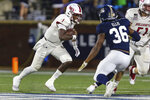 South Alabama quarterback Desmond Trotter (1) runs the ball during the first half of the team's NCAA college football game against Georgia Southern on Thursday, Oct. 29, 2020, in Statesboro, Ga. (AP Photo/Gary McCullough)