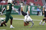 Memphis quarterback Brady White (3) gets tripped up in front of South Florida defensive back Devin Studstill (8) after a run during the first half of an NCAA college football game Saturday, Nov. 23, 2019, in Tampa, Fla. (AP Photo/Chris O'Meara)