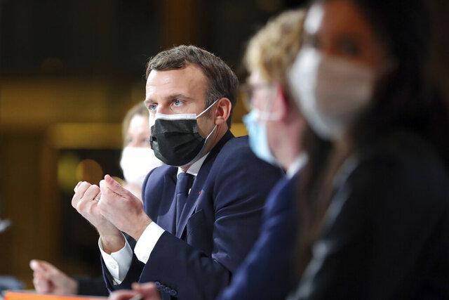 France's President Emmanuel Macron delivers a speech during a Citizens' Convention on Climate, in Paris, Monday, Dec. 14. (AP Photo/Thibault Camus, Pool)