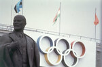 FILE - Lenin Stadium, the main stadium for the 1980 Moscow Summer Olympic Games and a Lenin statue are shown in this July, 1980 file photo. Just to hear chatter in the nation's capital about a possible boycott of the Winter Olympics in China had to be enough to alarm athletes already deep in preparation for the games. The United States and 65 other countries boycotted the Moscow Olympics. (AP Photo/File)