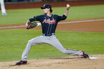 Atlanta Braves starting pitcher Max Fried throws against the Los Angeles Dodgers during the first inning in Game 1 of a baseball National League Championship Series Monday, Oct. 12, 2020, in Arlington, Texas.(AP Photo/Eric Gay)
