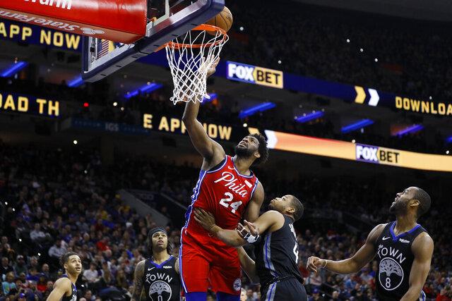 Philadelphia 76ers' Joel Embiid goes up for a shot against Golden State Warriors' Omari Spellman during the second half of an NBA basketball game Tuesday, Jan. 28, 2020, in Philadelphia. (AP Photo/Matt Slocum)