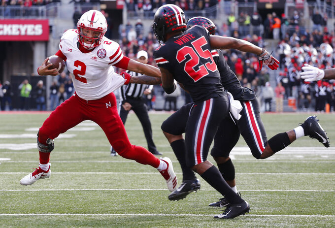 Nebraska quarterback Adrian Martinez, left, is stopped by Ohio State defenders Brendon White (25) and Damon Arnette during the second half of an NCAA college football game Saturday, Nov. 3, 2018, in Columbus, Ohio. Ohio State beat Nebraska 36-31. (AP Photo/Jay LaPrete)