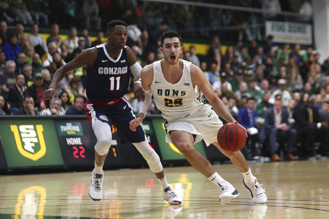 San Francisco guard Jordan Ratinho (25) drives against Gonzaga guard Joel Ayayi (11) during the first half of an NCAA college basketball game in San Francisco, Saturday, Feb. 1, 2020. (AP Photo/Jed Jacobsohn)