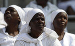 Mourners attend the state funeral service for former President Robert Mugabe at the National Sports Stadium in Harare, Saturday, Sept. 14, 2019. The burial has been delayed for at least a month until a special mausoleum can be built for his remains. (AP Photo/Themba Hadebe)