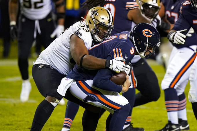 New Orleans Saints defensive tackle David Onyemata (93) sacks Chicago Bears quarterback Nick Foles (9) in overtime of an NFL football game in Chicago, Sunday, Nov. 1, 2020. (AP Photo/Nam Y. Huh)
