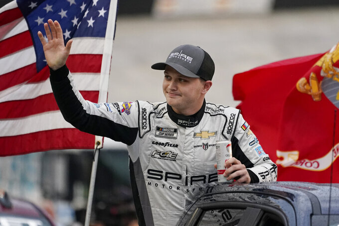 Justin Haley waves to fans before a NASCAR Cup Series auto race at Bristol Motor Speedway Saturday, Sept. 18, 2021, in Bristol, Tenn. (AP Photo/Mark Humphrey)