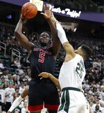 Rutgers forward Eugene Omoruyi (5) shoots as Michigan State forward Kenny Goins (25) defends during the first half of an NCAA college basketball game Wednesday, Feb. 20, 2019, in East Lansing, Mich. (AP Photo/Carlos Osorio)