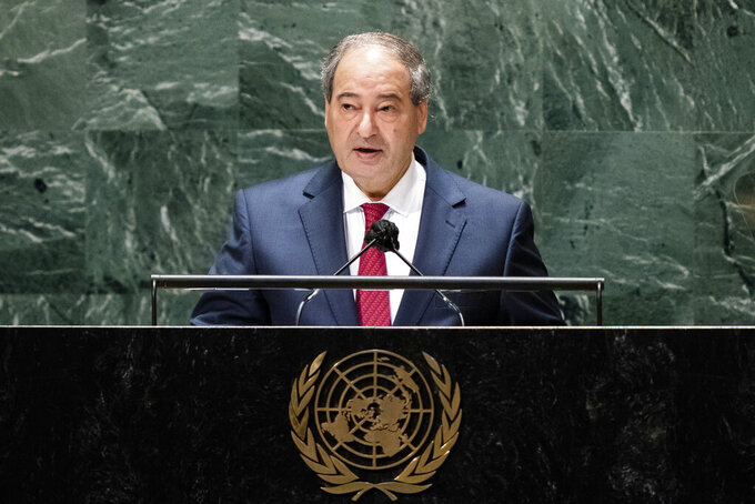 Syria's foreign minister Faisal Mekdad addresses the 76th Session of the United Nations General Assembly, Monday, Sept. 27, 2021, at U.N. headquarters. (AP Photo/John Minchillo, Pool)