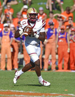 Boston College quarterback Anthony Brown scrambles while looking for a receiver during the first half of an NCAA college football game against Clemson, Saturday, Sept. 23, 2017, in Clemson, S.C. (AP Photo/Richard Shiro)