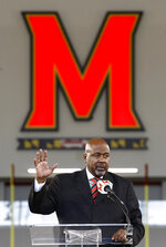 FILE - In this Dec. 6, 2018, file photo, Maryland's new head football coach Mike Locksley speaks at an NCAA college football news conference, in College Park, Md. Of all the things on the checklist of Maryland football coach Michael Locksley, none are more pressing than forming a bond with players who in 2018 dealt with the death of a teammate and the subsequent whirlwind of activity that transpired on and off the field.  (AP Photo/Patrick Semansky, File)