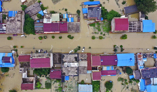 FILE - In this July 20, 2020, aerial file photo released by Xinhua News Agency shows the extent of flooding in Guzhen Town of Lu'an City in eastern China's Anhui Province. Summer floods in China have left more than 200 people dead or missing and caused $25 billion in direct damages, an emergency management official said Thursday, Aug. 13, 2020. The floods struck major river systems across the central and southern parts of the country. (Tang Yang/Xinhua via AP, File)