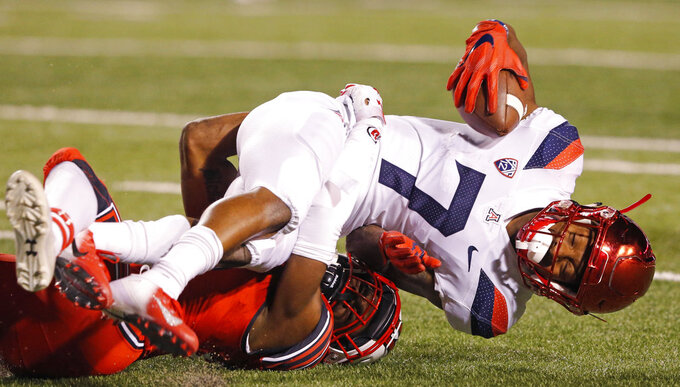 Utah defensive back Javelin K. Guidry, bottom, tackles Arizona wide receiver Devaughn Cooper (7) during the second half of an NCAA college football game Friday, Oct. 12, 2018, in Salt Lake City. (AP Photo/Rick Bowmer)