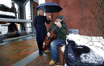 Sen. Kirsten Gillibrand, D-NY, sings along with street musician Kevin Clark, who plays a Cat Stevens' song, while touring Main Street in Concord, N.H., Friday, Feb. 15, 2019. Gillibrand visited New Hampshire as she explores a 2020 run for president. Clark said he's performed on the street since 2011. (AP Photo/Charles Krupa)