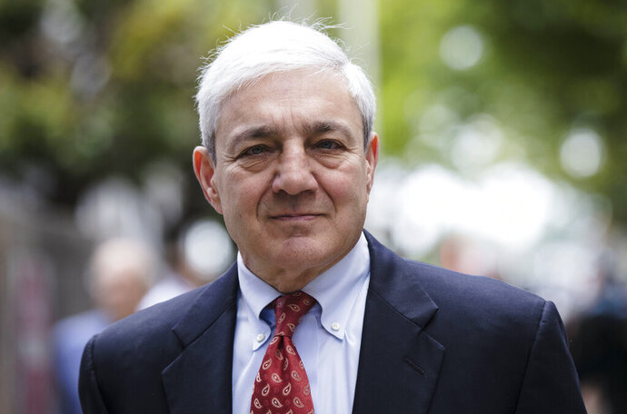 FILE - In this June 2, 2017, file photo, former Penn State President Graham Spanier departs after his sentencing hearing at the Dauphin County Courthouse in Harrisburg, Pa. A federal judge will consider ex-Penn State president Graham Spanier's argument that his conviction should be thrown out, a week before he's due to report to jail. The hearing Thursday, April 25, 2019, concerns Spanier's argument he was wrongly convicted in Pennsylvania state court for mishandling a 2001 complaint about Jerry Sandusky under a version of the law that wasn't in place at that time. (AP Photo/Matt Rourke, File)
