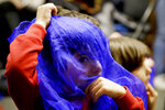 In this Jan. 23, 2019, photo, Samyar Najafi, 4, plays with a scarf during Persian story time at Irvine public library in Irvine, Calif. It's been four decades since the Iranian revolution overthrew the ruling shah, prompting tens of thousands of Iranian exiles and refugees to make their lives in the United States. Years later, they have set down roots here and are finding ways to pass their love of Iranian culture to their American children and grandchildren. (AP Photo/Chris Carlson)