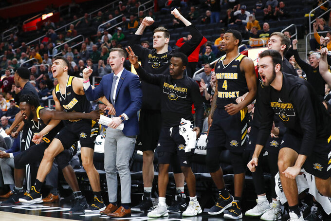 Northern Kentucky players celebrate a basket against Wright State during the second half of an NCAA college basketball game for the Horizon League men's tournament championship in Detroit, Tuesday, March 12, 2019. (AP Photo/Paul Sancya)