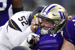 Washington quarterback Dylan Morris, right, is tackled by California linebacker Braxten Croteau (52) during the first half of an NCAA college football game, Saturday, Sept. 25, 2021, in Seattle. (AP Photo/Elaine Thompson)
