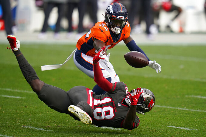 Tampa Bay Buccaneers wide receiver Tyler Johnson, below, can't make the catch as Denver Broncos defensive back Essang Bassey defends during the second half of an NFL football game Sunday, Sept. 27, 2020, in Denver. (AP Photo/Jack Dempsey)