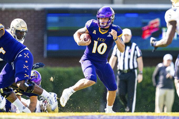 East Carolina quarterback Mason Garcia (10) runs against Navy during an NCAA college football game on Saturday, Oct. 17, 2020, in Greenville, N.C. (AP Photo/Jacob Kupferman)
