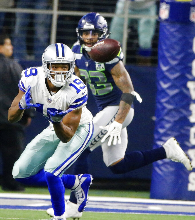 Dallas Cowboys wide receiver Amari Cooper (19) prepares to make the catch as Seattle Seahawks free safety Tedric Thompson (33) looks on during the second half of the NFC wild-card NFL football game, in Arlington, Texas, Saturday, Jan. 5, 2019. (AP Photo/Michael Ainsworth)