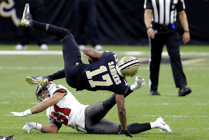 New Orleans Saints wide receiver Emmanuel Sanders (17) makes the catch as Tampa Bay Buccaneers strong safety Antoine Winfield Jr. (31) defends during the second half of an NFL divisional round playoff football game, Sunday, Jan. 17, 2021, in New Orleans. (AP Photo/Brett Duke)