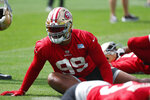 San Francisco 49ers defensive tackle DeForest Buckner stretches during practice for the NFL Super Bowl 54 football game, Friday, Jan. 31, 2020, in Coral Gables, Fla. (AP Photo/Wilfredo Lee)