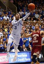 Duke's Tre Jones (3) drives to the basket against Boston College's Jordan Chatman (25) during the second half of an NCAA college basketball game in Durham, N.C., Tuesday, Feb. 5, 2019. (AP Photo/Chris Seward)