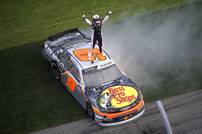 Noah Gragson (9) celebrates on the roof of his car at the finish line after winning a NASCAR Xfinity series auto race at Daytona International Speedway, Saturday, Feb. 15, 2020, in Daytona Beach, Fla. (AP Photo/Phelan M. Ebenhack)